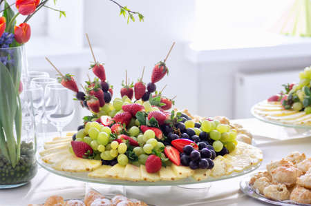 Fruits and beriies in aplte on a buffet table. Close up. Imagens