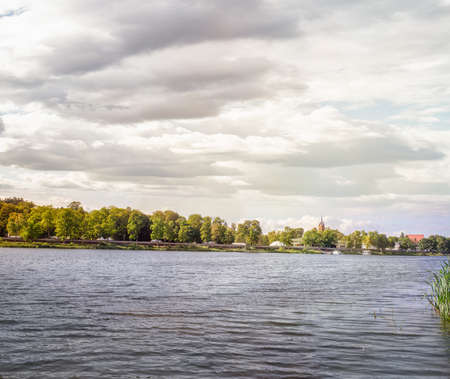 Birstonas is a balneological resort and a spa town in Lithuania situated 30 km (19 mi) south of Kaunas on the right bank of the Nemunas River. Panoramic view of quay on cloudy autumn day