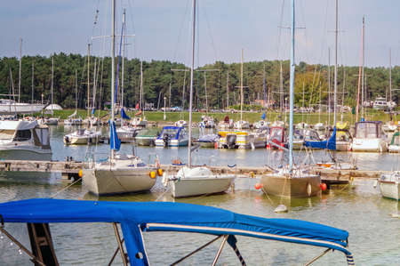 Boats and yachts in a harbour on a sunny day. Kaunas, Lithuania.