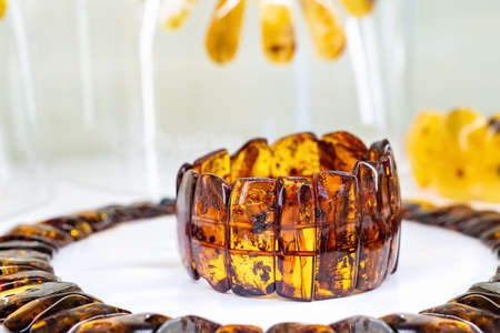 Amber bracelet on a white background. Close up.