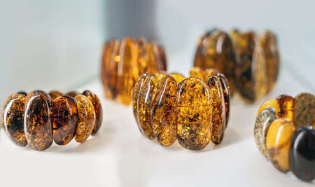 Amber bracelets on a white background. Close up. Imagens