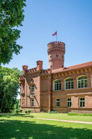 Raudone Castle is a residential castle (estate, manor) of the 19th century in Raudone, Lithuania. Today it is used as a public school.