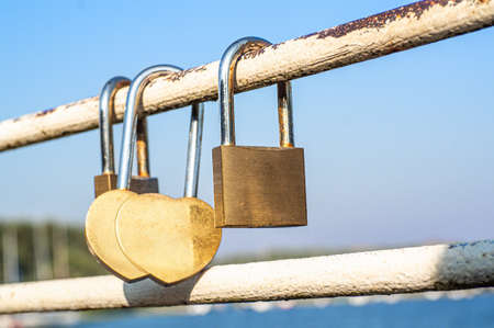 Close view of padlocks on a bridge in a blue sky background Stok Fotoğraf