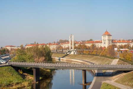 Simonas Daukantas pedestrian bridge to Nemunas Island in Kaunas on sunny autumn day. Lithuania.