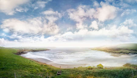 Panoramic view of seashore in County Cork on a hazy and cloudy day. Ireland.