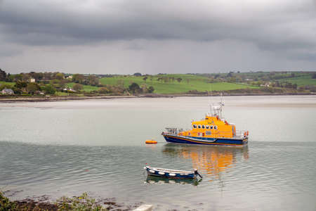 Lifeboats in a river   Arigideen delta at low tide. County Cork, Ireland.