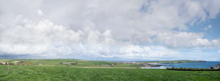 Panoramic view of Garrettstown beach in County Cork on a  cloudy day. Ireland.
