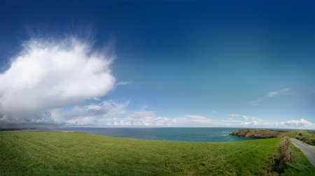 Panoramic view of Old Head of Kinsale with lighthouse in spring. County Cork, Ireland.