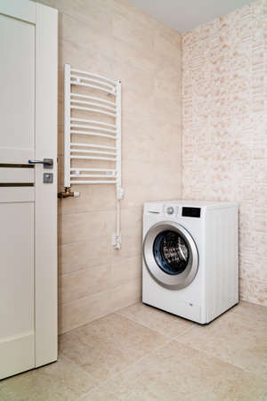 Washing machine and an electric heater in thebathroom.