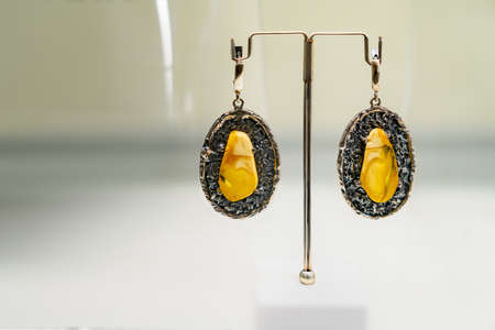 Beautiful earings with amber. Close up.