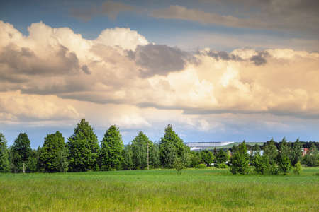 Summer landscape with Kruonis Pumped Storage Plant in the horizon. Lithuania.