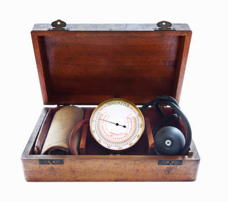Vintage Tonometer in wooden box. Close up. Isolated on white.