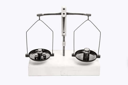 Mechanical scales with weights on a white background. Close up. Imagens