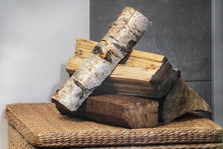 Birch, fir and pine firewood next to the fireplace. Close view. Imagens