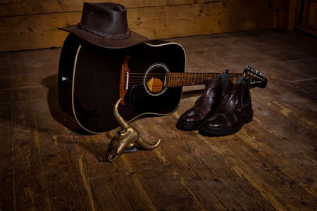 Guiatr for country music a hat and boots all you need to country dance.