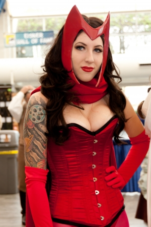 breast comic: San Diego Comic Con July 21-24, 2011. The world's largest convention of its kind featuring media, movies, comic books, anime, entertainment, video games and more! Photo of sexy woman dressed as Scarlet Witch taken on July 23rd, 2011.