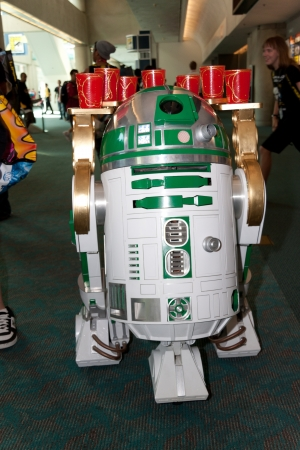 San Diego Comic Con July 21-24, 2011. The world�s largest convention of its kind featuring media, movies, comic books, anime, entertainment, video games and more! Photo of green R2D2 serving drinks taken on July 23rd, 2011. Stock Photo - 14311809