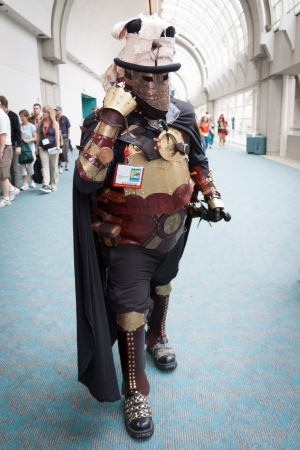 San Diego Comic Con July 12-15, 2012. The world's largest convention of its kind featuring media, movies, comic books, anime, entertainment, video games and more! Photo of Steampunk man dressed in heavy armor taken on July 12th, 2012. Stock Photo - 14542005