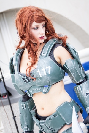 largest: San Diego Comic Con July 12-15, 2012. The world's largest convention of its kind featuring media, movies, comic books, anime, entertainment, video games and more! Photo of attractive woman dressed in armor from Halo taken on July 12th, 2012.