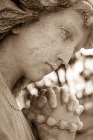 angel cemetery: Closeup shot of an angel praying statue Stock Photo