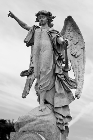 Angel pointing towards heaven photo