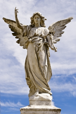 angel headstone: Angel statue on a pedestal Stock Photo