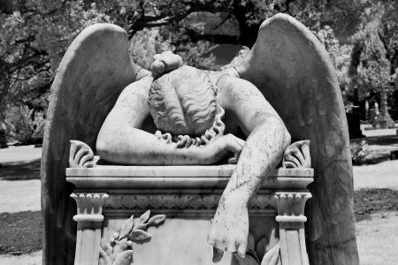 grieving: Sorrowful angel weeping