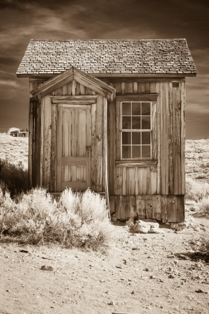 western town: Small old building in sepia tone  Stock Photo