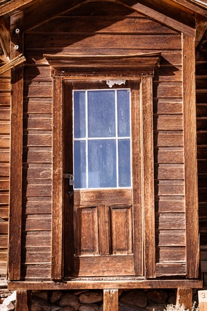old mining building: Close up shot of old weathered wooden door