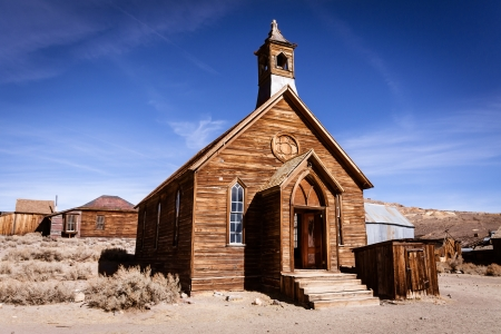relics: Old weathered wooden church in ghost town