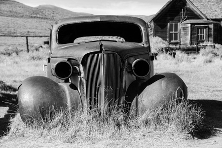 Old abandoned car in black and white has seen better days  photo