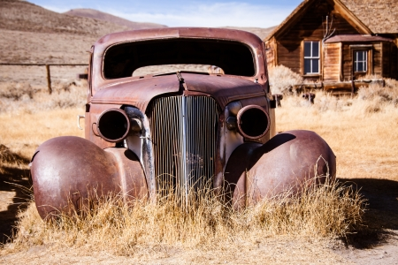 better days: This old abandoned car has seen better days  Stock Photo