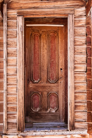 Close up shot of old weathered wooden door  photo