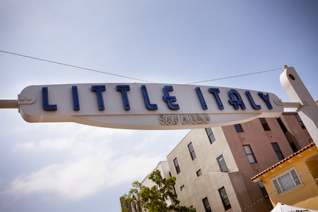 Little Italy sign against blue sky.