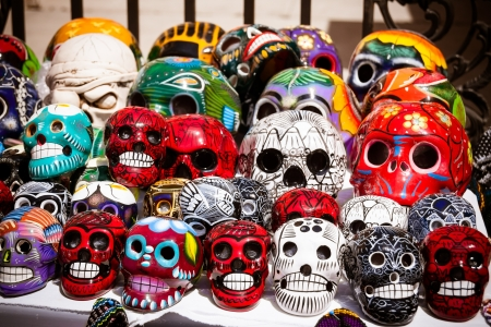 mexican folklore: An assortment of colorful Mexican sugar skulls at a street fair