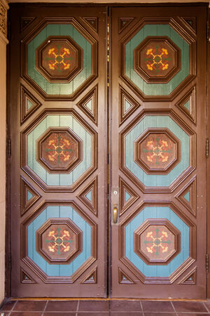 Front view of blue and brown ornate door