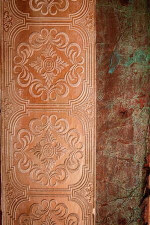 Embossed design on old door. Stock fotó