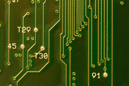transistor: Close up of green circuit board with numbers and letters