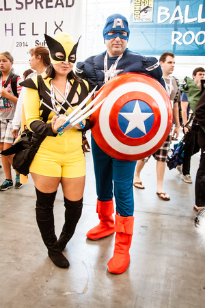 San Diego Comic Con, July 18-21, 2013. The worlds largest convention of its kind featuring media, movies, comic books, anime, entertainment and more. Photo of couple dressed as Captain America and Wolverine taken on July 20th, 2013.