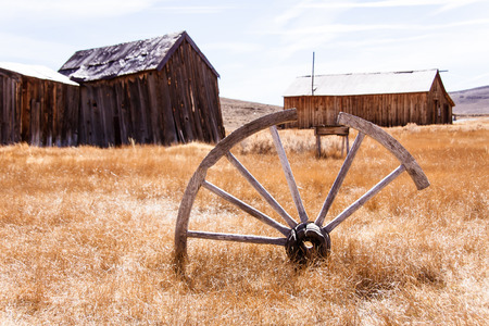 wheel house: Old wagon wheel Stock Photo