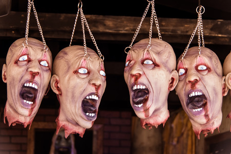 Four scary beheaded props at a funhouse