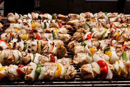 Rows of grilled chicken kebabs at the county fair
