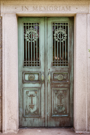 crypt: Front view of weathered mausoleum door