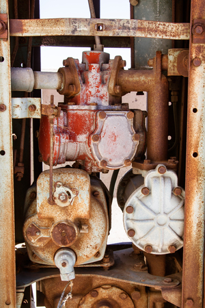 Close up view of a rusty old engine. photo