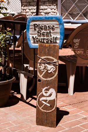 Sign outside a restaurant for patrons.
