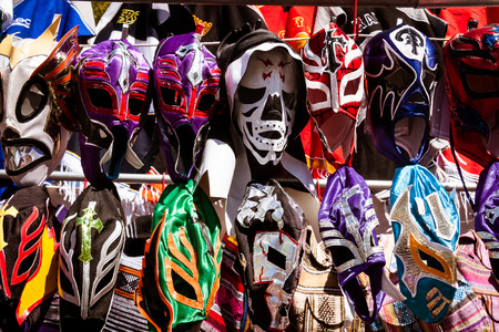 A display of colorful Mexican wrestling masks.