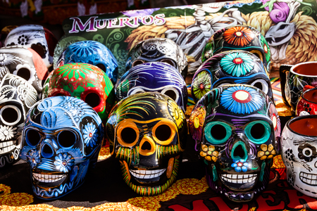 Display of colorful sugar skulls during Dia de los Muertos event.