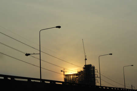 Sunset on buildings under construction near the bangkok Expressway Thailand photo