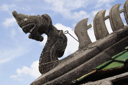 morn: Laterite dragon on Ancient Temple roof of  Wat Srangsok or Wat Morn  more than 200 years old temple located in Samutprakarn Province Thailand Stock Photo