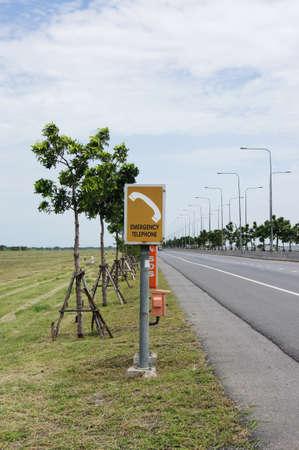 Emergency telephone box on the roadside photo